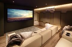 "Sound dampening is key for home cinemas with smooth surfaces like wooden floors. (""House Dainfern Home Cinema,"" by BNC in South Africa -- 2019 CEDIA Award Finalist, EMEA Region, Home Cinema Level I)"